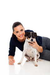 pretty woman playing with her dog isolated on white background