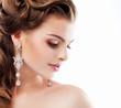 Aristocratic Lady with Diamond Earrings. Femininity