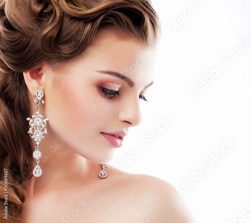 Aristocratic Lady with Diamond Earrings. Femininity