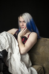 Beautiful Young Goth Woman with Blue Hair and Red Corset