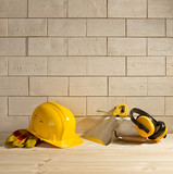 brick background, helmet and trowel