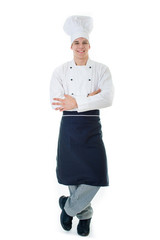 Portrait of smiling cook in chefs hat and uniform