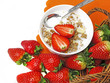 healthy breakfast - cereal with strawberries on white background