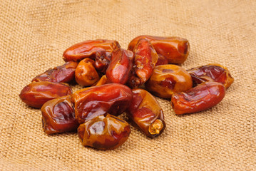 dried dates on canvas background