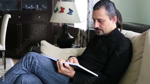 man reading book and get the bad news