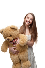 girl holding soft toy bear