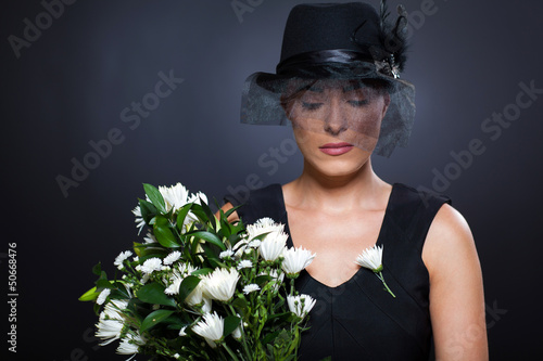 widow with flowers