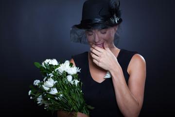 sad widow crying at funeral