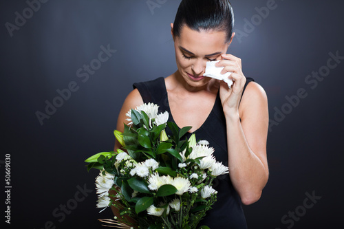 sad woman in mourning clothes crying