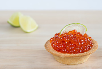Tartlet with red caviar and lime