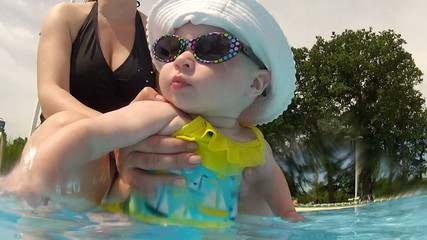 Cute baby having fun at the pool
