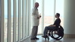 Man in wheelchair talking with doctor