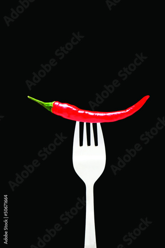 Red pepper isolated on the black background