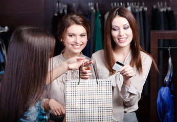 Pretty women pay a bill with credit card