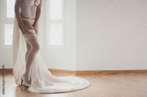 Sexy bride putting her heels up