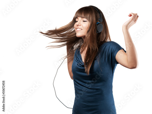 young woman is dancing to music - isolated