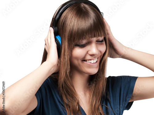 young woman smiling about her music - isolated