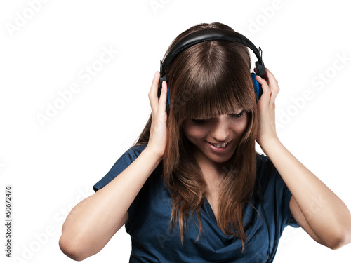 young woman is happy with her music - isolated
