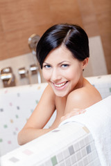 Beautiful beautiful girl relaxes in bath, hygiene concept