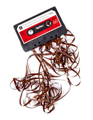 Old worn down eighties cassette with band pulled out
