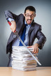 Businessman cutting the pile of paper