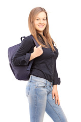 A smiling female student with a backpack