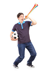 Full length portrait of a male sport fan holding a football and