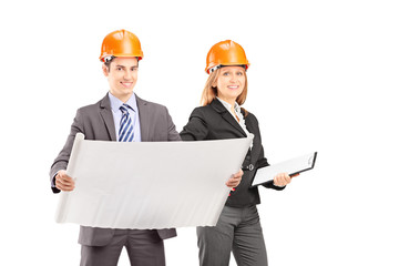 Male and female engineers posing