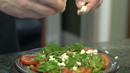 Mozzarella spread over a fresh caprese salad