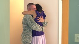 Soldier coming home and hugging his wife