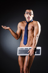 Businessman in   pants with keyboard