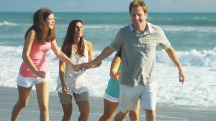 Happy Caucasian Family Running Outdoors on Beach