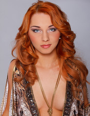 Serious redhead woman in sexy dress