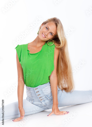 Blond girl is sitting on twine