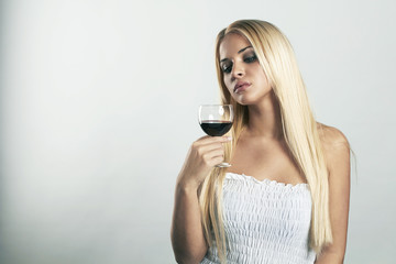 Beautiful blond woman with glass of wine