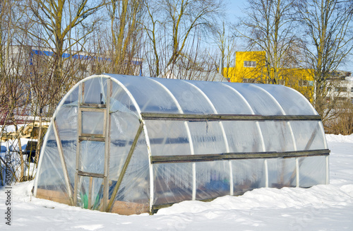 Leinwanddruck Bild handmade polythene greenhouse for vegetable  in winter  on snow