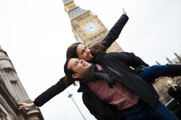 Piggyback ride in front of the Big Ben.