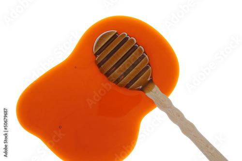 Honig und Honiglöffel im Durchlicht