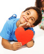 Cute five years old boy with heart symbol