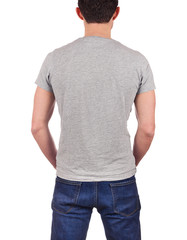 back view of young man wearing blank gray t-shirt