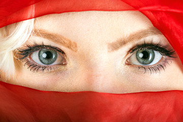 Face of a veiled blonde woman