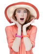Surprised redhead girl in hat.