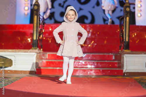 Girl walks runway during kids fashion show