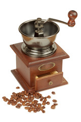 Antique coffee grinder and coffee beans