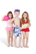 Boy and two girls in beach suits, boy with swimming mask