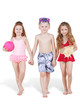 Three children in beach suits go holding hands