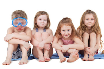 Children in beach suits - boy in diving mask and three girls
