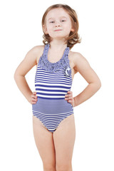 Little girl in striped swimsuit poses