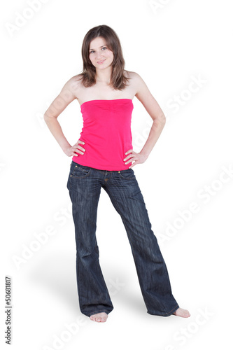 Young barefooted woman in blue jeans and in red blouse