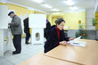People casting ballots on elections to duma